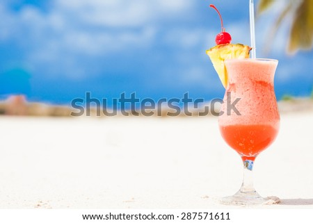 picture of fresh fruit cocktail on tropical beach - stock photo
