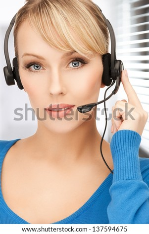 picture of friendly female helpline operator with headphones - stock photo