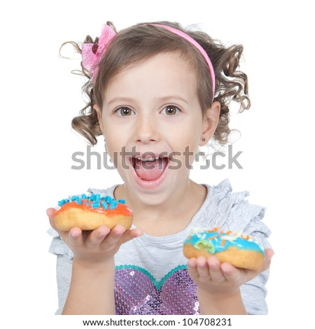 Picture of funny little girl with colorful donuts on white background - stock photo
