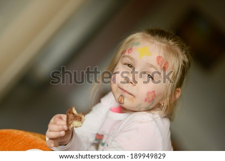 Picture of funny little girl with donuts - stock photo