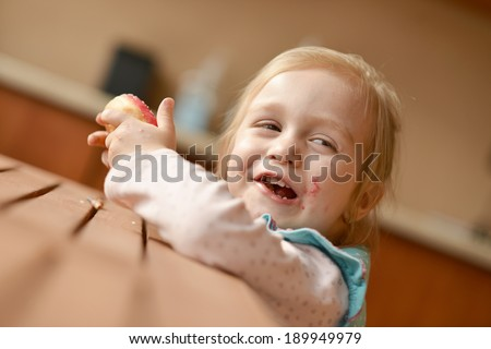 Picture of funny little girl with donuts