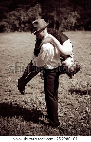 Picture of gangster steals woman - stock photo