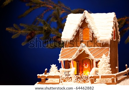 picture of gingerbread house over christmas background - stock photo