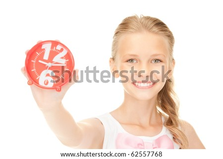 picture of girl holding alarm clock over white - stock photo