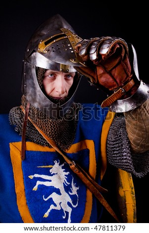 Picture of glory knight opening his helmet - stock photo