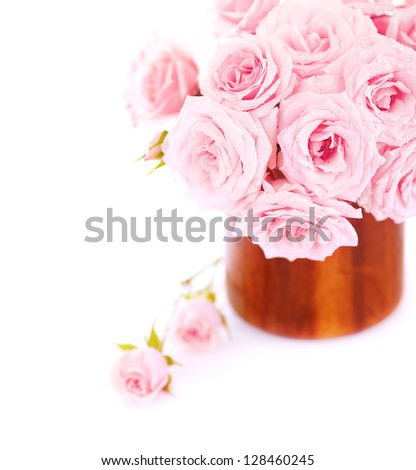 Picture of great rose bouquet in wooden pot isolated on white background, pink bridal bunch in vase in studio, romantic holiday gift, wedding day, mothers day, spring season, romance and love concept - stock photo