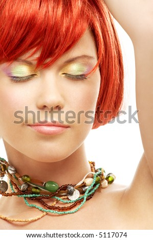 picture of green beads redhead with eyes closed