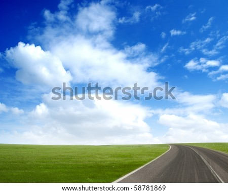 Picture of green field and blue sky - stock photo