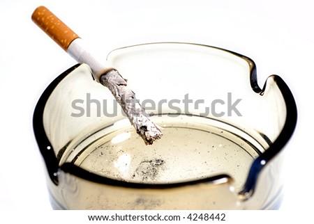 Picture of half burned cigarette in ash tray. - stock photo