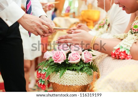 Picture of Hands Pouring Blessing Water into Bride's Hands, Thai wedding