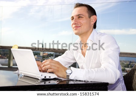 picture of handsome businessman on leisure with laptop