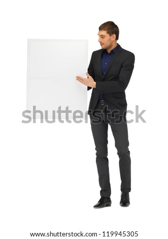 picture of handsome man in suit with a blank board.