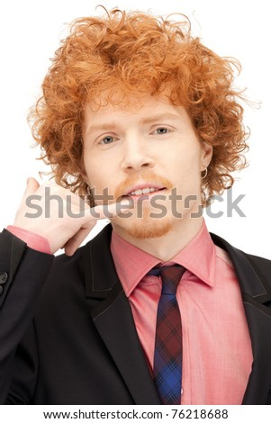 picture of handsome man making a call me gesture