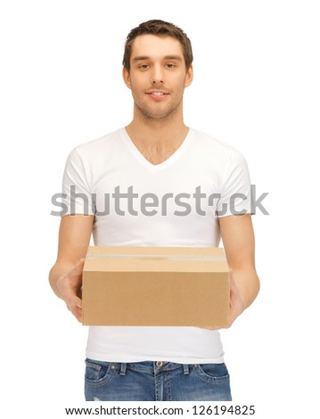picture of handsome man with big box. - stock photo