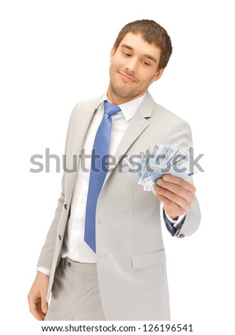 picture of handsome man with euro cash money - stock photo