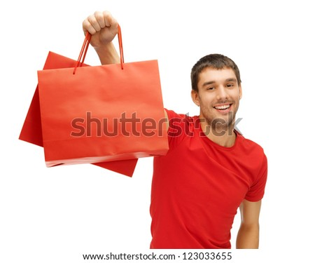 picture of handsome man with shopping bags - stock photo