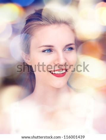 picture of happy and smiling teenage girl with city lights - stock photo