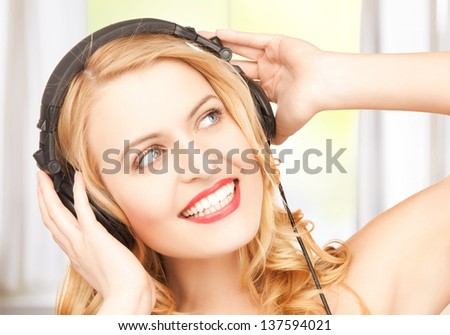 picture of happy and smiling woman with headphones