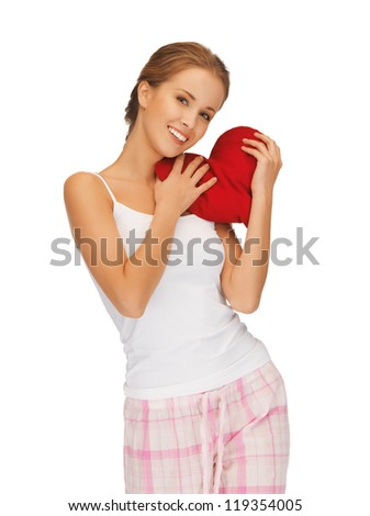 picture of happy and smiling woman with heart-shaped pillow