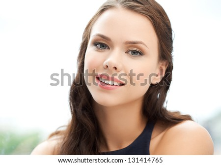 picture of happy and smiling young elegant womanl outdoors - stock photo
