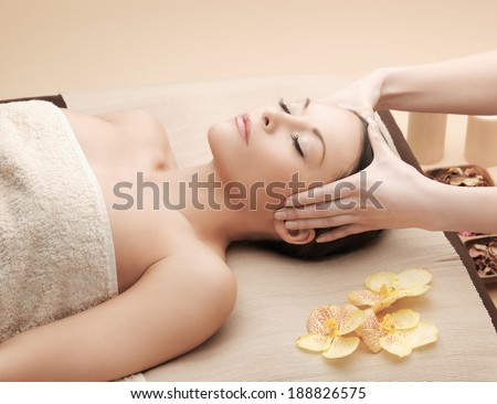 picture of happy beautiful woman in massage salon - stock photo