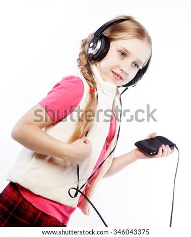 picture of happy blond girl in big headphones  - stock photo