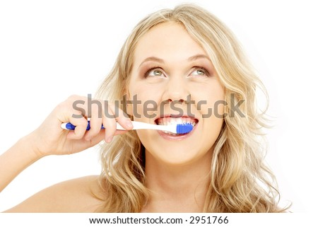 picture of happy blond with toothbrush over white