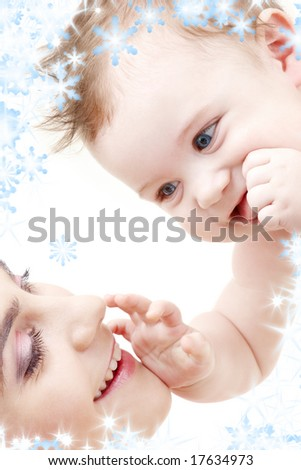 picture of happy blue-eyed baby boy touching mama - stock photo