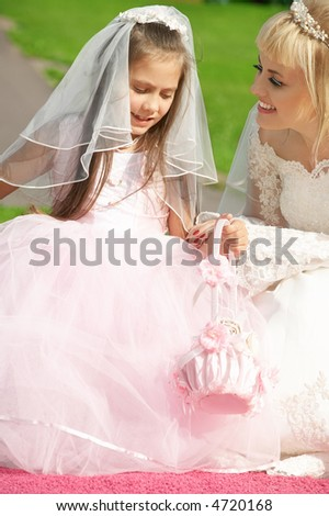picture of happy bride and little bridesmaid - stock photo