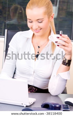 picture of happy businesswoman with laptop computer