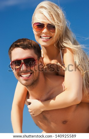 picture of happy couple having fun on the beach - stock photo