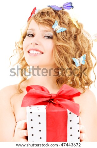 picture of happy girl with gift and butterflies over white