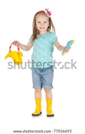 Picture of happy little girl in the yellow boots over white - stock photo