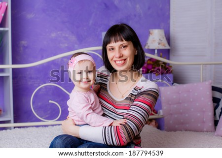 picture of happy mother with adorable baby at home - stock photo