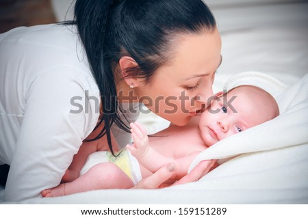 picture of happy mother with baby - stock photo