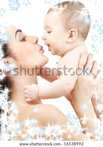 picture of happy mother with baby and snowflakes - stock photo