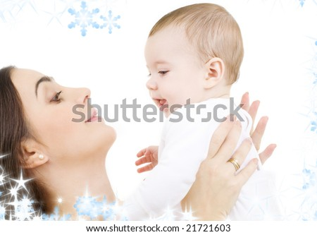picture of happy mother with baby and snowflakes