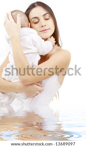 picture of happy mother with baby boy in water - stock photo