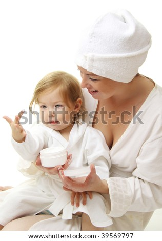 picture of happy mother with baby holding cosmetic cream