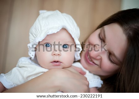 picture of happy mother with baby in hands - stock photo