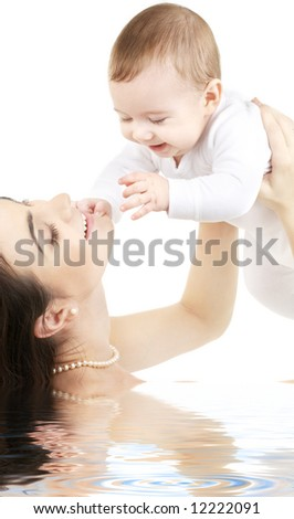 picture of happy mother with baby in water