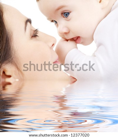 picture of happy mother with baby in water - stock photo
