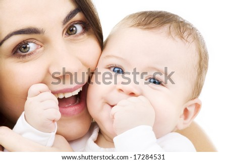 picture of happy mother with baby over white (focus on baby) - stock photo