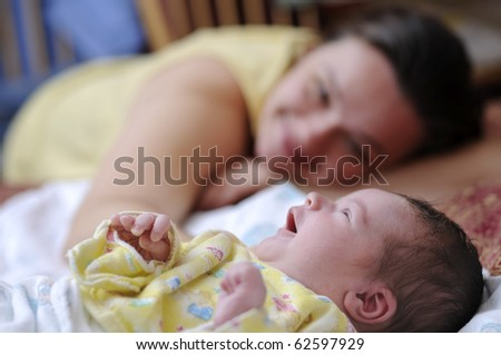 Picture of happy mother with newborn baby - stock photo