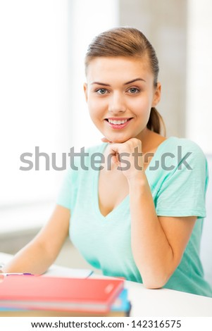 picture of happy smiling student girl with books - stock photo