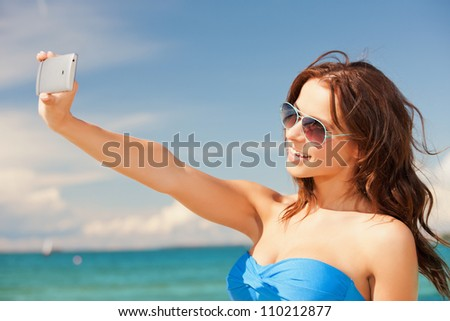 picture of happy smiling woman using phone camera .