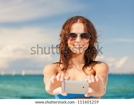 picture of happy smiling woman using phone camera . - stock photo