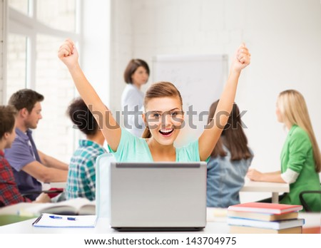 picture of happy student girl with laptop at school - stock photo