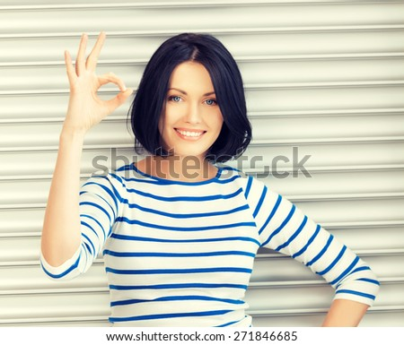 picture of happy teenage girl showing ok sign - stock photo