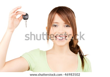 picture of happy teenage girl with car key - stock photo